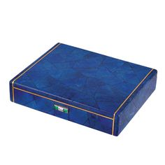 Art Deco Gold and Lapis Box, by Cartier  18 kt., the gold box applied throughout with lapis sections arranged in a geometric pattern, edged by slender gold, the thumbpiece set with one baguette diamond flanked by 2 square-cut emeralds, unsigned, with French assay mark, no. 02944, circa 1930.
