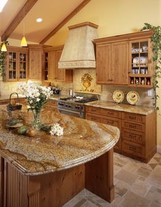 Take a peek at this charming country kitchen! The cabinetry and countertops work perfectly together and both are beautifully accented by the sunny yellow walls.