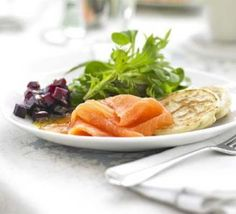 Garden leaves with smoked salmon & cheat's blinis