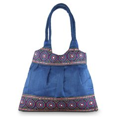 NOVICA Handmade Embroidered Shoulder Bag with Zipper, 'Blue and Rose Mandalas'. Authentic: an original NOVICA fair trade product in association with National Geographic. Certified: comes with an official NOVICA Story Card certifying quality & authenticity. NOVICA works with Om Prakash to craft this item. Exceptional Quality: crafted with care to be treasured as a keepsake for many years to come. Product info: 100% polyester, metallic yarn and rayon trim, plastic sequins. Polyester lining.