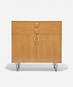 George Nelson & Associates; Oak and Enameled Steel 'Basic Cabinet' for Herman Miller, 1952.