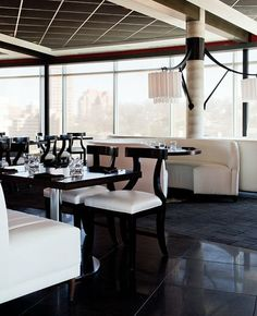 Sleek banquettes border the dining area. Rosso | Kansas City Spaces