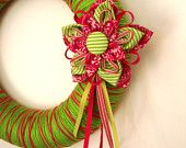 Decorative Christmas wreath wrapped in yarn and embellished with handmade decorations READY TO SHIP. $38.00, via Etsy.