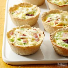 Ham and Swiss Quiche Cups Mini quiches are a staple at any brunch. Our classic ham-and-Swiss version gets an extra boost of flavor from a sprinkling of sliced green onions. Ham And Swiss Quiche, Ham And Cheese Quiche, Ham Quiche, Swiss Cheese, Frittata, Cheese Muffins, Egg Muffins, Cheddar Cheese, Quiche Recipes