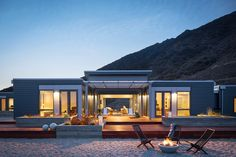 Desert home with fire pit and lounge chairs