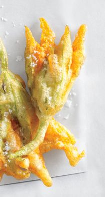 Fried Zucchini Blossoms are a great dish to make as soon as the blossoms appear at the farmer's market- I stuff mine with mozzerella cheese
