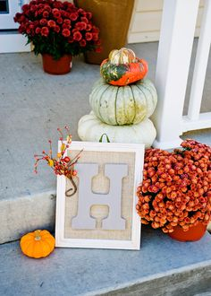Front door framed inital sign. 11x13 frame. paint frame copper. take it apart. stretch burlap across frame insert. paint wood letter. glue gun down. small ribbon loop w staple gun on back to hang on door. seasonal embellishment.