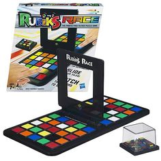 """Rubik's Race game.  Fun!  Challenging!  """"Race to slide your colored tiles and be the first to complete the pattern shown on the Scrambler."""""""