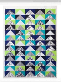 Flying Geese, lime & navy. The geese are neutral patterns and the skies are solid.