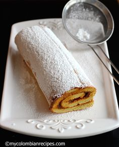 Dulce de Leche and Coconut roll.I boiled a can of sweetened condensed milk and used that instead of buying dulce de leche.this recipe is so easy and yummy! Colombian Desserts, Colombian Food, Colombian Recipes, Peruvian Desserts, Peruvian Recipes, Sweet Desserts, Delicious Desserts, Cake Recipes, Gowns
