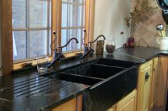 Black Soapstone Sink.  A triple bowl Soapstone Sink with duel faucet.  Manufactured in Austin, TX and installed in San Antonio.