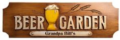 Beer Garden Personalized Sign. Our Beer Garden sign is created from Artist Al Pisano's original wood carving. Each sign is cast and then carved with your name or phrase. The Beer sign is hand painted and stained to capture all the detail and depth of the original wood carving. The sign measures 30 inches by 9 inches and about 1 inch deep. There are hangers on the back. Indoor or outdoor use. Made in USA.
