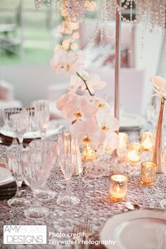 Beautiful detailed shot of hanging white  orchids with silver votive candles. White and silver always make a great combination! #glamorous