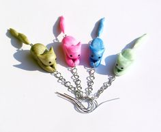 Cute kawaii chibi-styled miniature kittens made with polymer clay.