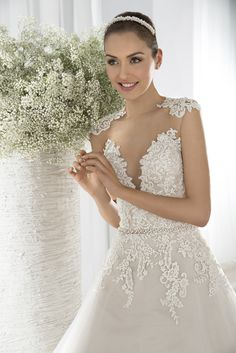 Lace bodice and high illusion neckline above plunging sweetheart neckline. #DemetriosBride Style 632.
