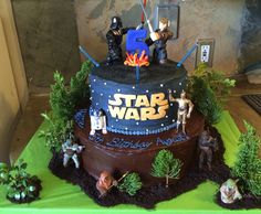 Star Wars cake I made for a 5yr olds birthday party. Bottom tier is Devils food Chocolate cake, with chocolate frosting. Top one is blue velvet cake, with Midnight blue, and dark grey swirled buttercream. Letters are made of fondant.