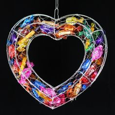 A lovely wire shape full of brightly-coloured Quality Street & Roses chocolates- it makes a terrific Christmas wreath!