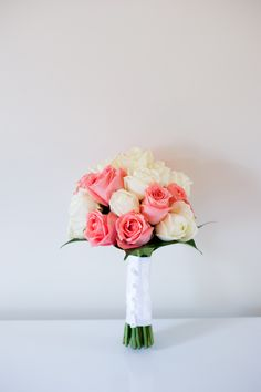 coral rose and ivory rose bouquet