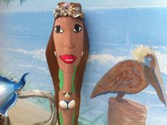 Mermaid painted on palm frond