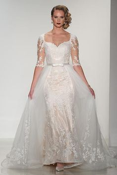 Wedding gown by Matthew Christopher.