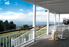 would love a porch and view like this, all thats' missing is the dogs.The porch at Oprah's Hawaii house