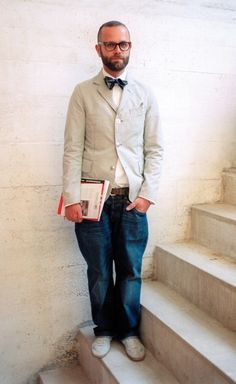 Scholarly three button jacket and bow tie paired with casual jeans and canvas sneakers. ~s