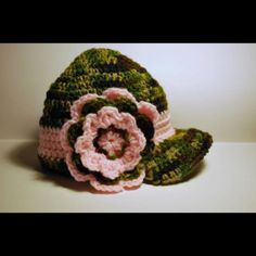 Camouflage hat with pink flower that I crocheted for a friend