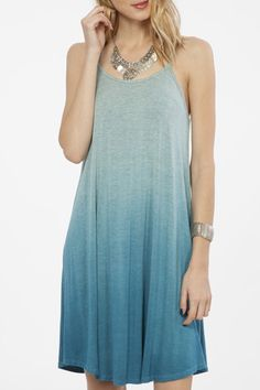 Get ready for spring and summer with our Jade dress. This ombre blue dress has a racerback, very light weight and sure to keep you comfortable with the soft material. Be sure to pack it with your othe