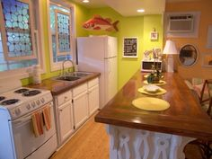 Wood countertops on white cupboards