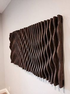 This parametric wall wave is a visually intriguing piece of wall art. Comprised of 47 individually cut pieces of cabinet grade oak plywood that spaces apart to displays a sweeping and organic parabolic wave. This piece is 58 long, 28 wide, and 3 thick Art Sculpture En Bois, Modern Sculpture, Wall Sculptures, Sculpture Ideas, Wooden Wall Art, Wooden Walls, Wall Wood, Wooden Wall Design, Grand Art Mural