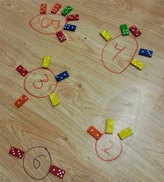 Here's one way to use those Woolworths dominoes! Write a number in a circle and have students place the dominoes that add up to that number around it.