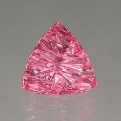 This 3.73-carat Hot Pink Tourmaline gemstone features the RippleTop™ cut.  Hot…