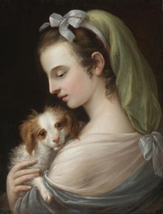 German School, 18th Century - A WOMAN WITH A KING CHARLES SPANIEL, oil on canvas 19 5/8 by 15 1/8 in.; 50 by 38.5 cm.