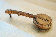 Vintage Banjo Belt Buckle - Brass Banjo, Vintage Buckle, Solid Brass, Bluegrass Banjo, 1970s. $35.00, via Etsy.