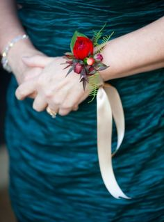Delicate floral wrist corsage with ranunculus, hypericum and plumosa fern by Daisy Rose Floral Design, © Megan Clouse Photography
