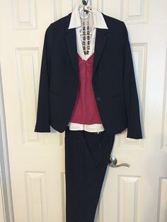 Navy pants, white collar shirt, raspberry sweater, navy jacket