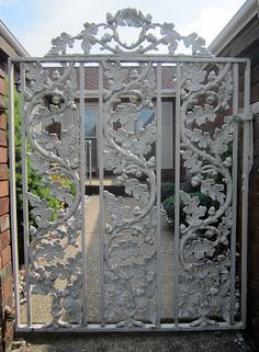 My grandfather handmade this gate to their home. They have similar panels in their house. He had a thing for acorns, apparently.