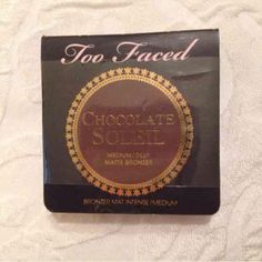 Chocolate Soleil New. & Sealed Too Face Chocolate Bronzer / medium deep . Deluxe Trail Size . Smells amazing. . Price is negotiable bundle and save. Look at all listings . Not all is posted I might have something you need . Too Faced Makeup Bronzer
