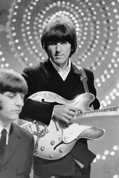 Ringo Starr (left) and George Harrison from The Beatles perform 'Rain' and 'Paperback Writer' on BBC TV show 'Top Of The Pops' in London on June (Photo by Mark and Colleen Hayward/Redferns) Ringo Starr, George Harrison, The Beatles Story, Bbc Tv Shows, Paperback Writer, John Lennon Beatles, Beatles Band, Beatles Photos, The Fab Four