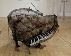 The work of young Québécois artist Jannick Deslauriers emphasizes art's most fragile elements, through a mass of translucent fabric. Her delicate fibre art spins out thread sculptures that send strong messages, covering the ghosts of cities, people and of war. (Above: Piano, 2010-11, crinoline, rigid mesh, organza and thread)