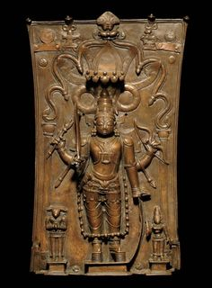 A BRONZE REPOUSSÉ PLAQUE OF VIRABHADRA, Daksha on his left. 17th C. India
