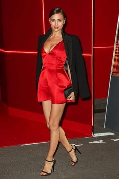 Irina Shayk - In a low-cut flare dress by Christian Dior at L'Oréal Red Obsession Party during Paris Fashion Week on March 8, 2016, in France. LaurentVu/SIPA/REX/Shutterstock