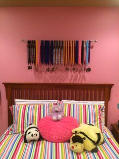 Madelyn's room - got her gymnastics medals displayed. She loves it. Mom loves it because it was a $15 curtain rod!