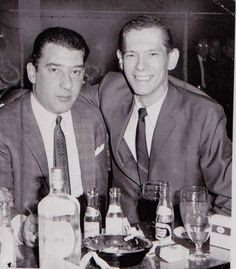 Ronnie Kray (L) having drinks with American singer Johnny Ray
