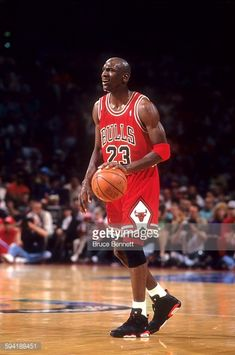 Michael Jordan of the Chicago Bulls dribbles the ball during a game in the 1991 Eastern Conference Semifinals against the Philadelphia 76ers in May...