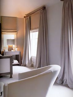 plain curtains and matching blinds they will be a big part of the room so will make impact enough being plain