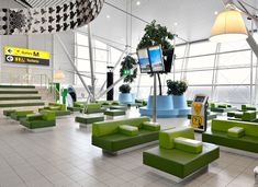 open, airy lounge space   - Schiphol Departure Lounge 4 by Tjep.