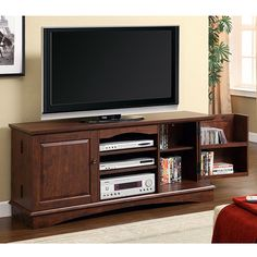 Make your television the centerpiece of your living room with this large wood TV console. This console provides space for up to 200 DVDs and all of your electronic accessories.