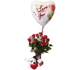 Doggy Style! Oh yea, we went there! Lucy, Soderberg's Floral and Gift - Shop pooch recomends this bouquet of dozen red roses, solid chocolate heart,  I love you mylar ballon AND a white puppy holding the biggest red plush heart!