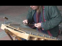 Amazing hammered dulcimer player in Central Park, NYC (2009). The performer is Arlen Oleson.
